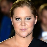Amy Schumer jokes 'I'm still pregnant' as she shows off huge bump