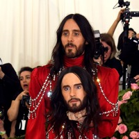Jared Leto carries a model of his head at the Met Gala