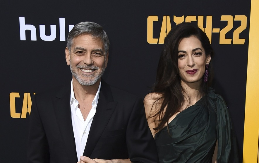 George and Amal Clooney switch on the glamour at premiere - The