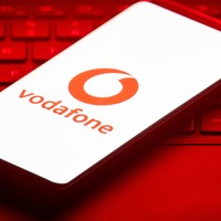 Vodafone swings to £6.6 billion loss and cuts divi for first time