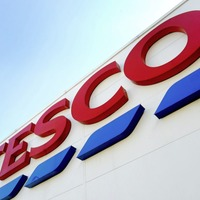 Three men stole almost £7,500 worth of alcohol and goods from Tesco stores