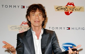 Sir Mick Jagger 'rocks out new tunes' on guitar following heart op
