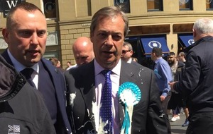 Nigel Farage hit by milkshake during campaign walkabout