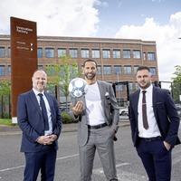 Rio Ferdinand helps launch New Era soccer agency office in west Belfast
