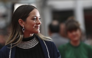 Marion Cotillard wears crop top and shorts on Cannes red carpet