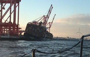 Container ship evacuated in Liverpool after sharp tilt