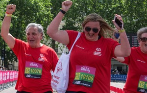 Jim Carter runs a mile alongside disabled people for Special Olympics