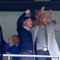 Prince William and John Carew celebrate Aston Villa's promotion together