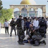 Israeli security forces clash with Muslim worshippers at Jerusalem holy site.