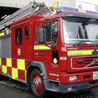 Firefighters battle deliberate blaze at former Co Antrim school