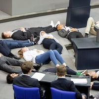Students stage 'die-in' climate protest in German parliament