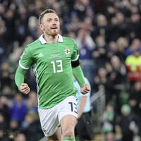 Northern Ireland and Corry Evans happy to have gone up in the world