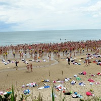 Hundreds of women strip off for cancer charity skinny dip