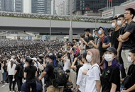 Hong Kong police use tear gas against protesters massed outside government buildings.