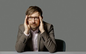 Divine comedian Neil Hannon discusses Office Politics, Adam Ant and Reggie Perrin