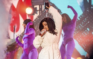 Cardi B performs in bathrobe after wardrobe malfunction