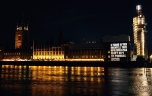 Grenfell campaigners project message on to Houses of Parliament