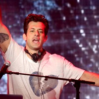 Mark Ronson's fans keep throwing Curly Wurly bars at him on stage