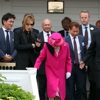 Queen unruffled as polo guest's scarf lands on her shoulder