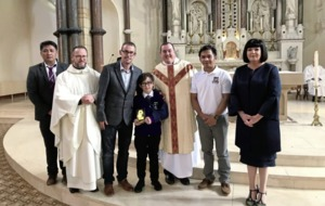 St Patrick's PS pupil Rowan presented with Honouring the Faith award