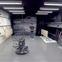 Hopping space robot plays live-action ping pong