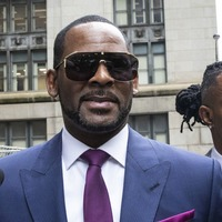 R Kelly held by police on sex crime charges in Chicago