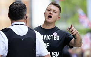 Tommy Robinson appears to show support for soldier F with badge