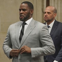 R Kelly in court after being arrested over sex crimes