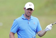 Rory McIlroy wears polo shirt featuring washing-machine logo