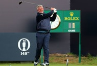 A proud Darren Clarke hits the first tee shot of the Open at Royal Portrush