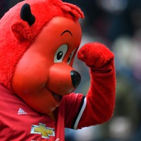 Manchester United mascot Fred the Red hit with drink after taunting Leeds fans