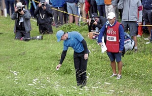 DODGY TACKLE: Rory McIlroy's Open Championship nightmare shows golf is still not as easy in real life