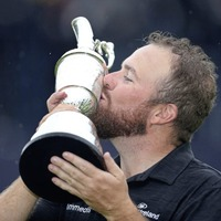 Shane Lowry revels in the wet weather to write himself into Open history book