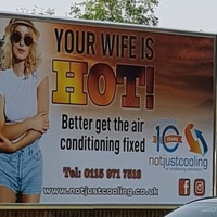 Air conditioning firm defends advert with slogan 'your wife is hot'