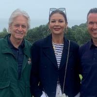 Catherine Zeta-Jones and Michael Douglas at golf course before Swansea ceremony