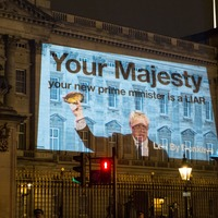 Campaigners project image of Boris Johnson waving kipper onto Buckingham Palace