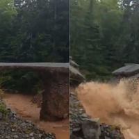 Watch: Road washed away by Canada flooding