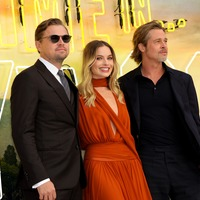 Margot Robbie dazzles in plunging burnt orange gown at Tarantino premiere