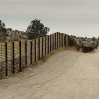 Seesaws on US-Mexico border allow citizens to connect through the wall