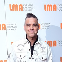 Robbie Williams shares excitement at meeting 'lifelong hero' John Travolta