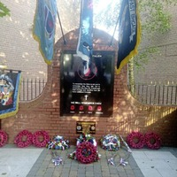 Loyalist paramilitary flags placed on war memorial in south Belfast