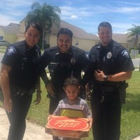 Police deliver pizza to boy who called 911 because he was hungry