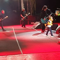 Boy, five, delights crowd by dancing on Belfast stage with Foo Fighters