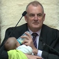 Touching images show New Zealand speaker feeding colleague's baby during debate