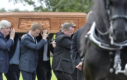 Mourners gather in Co Antrim to pay respects to businessman John Mulholland