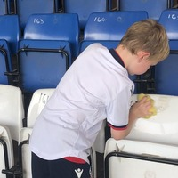 Bolton fan, 7, scrubs seats as rival supporters gather to help crisis-hit Bury