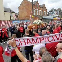 Cliftonville players and fans honour legendary manager Tommy Breslin