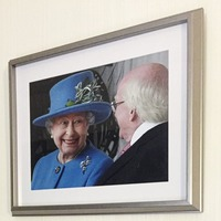Queen Elizabeth with Michael D Higgins among the restored portraits at Stormont House