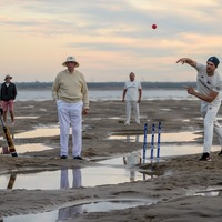 In Pictures: Soggy infield no boundary for sandbank cricket match
