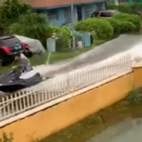 Jet-ski ride on flooded streets offers 'comedic relief' amid Hurricane Dorian